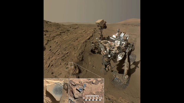Scéna ukazuje vesmírne vozidlo Mars na mieste, kde objavilo horniny s mangánovými oxidmi, ktoré potrebujú k tvorbe vysoký dostatok vody a kyslíka.