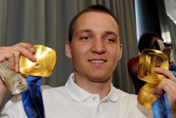 S olympijskými medailami.
