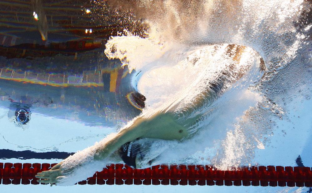 Plávanie, štart pretekov na 1500 metrov voľným spôsobom, Oussama Mellouli z Tuniska.