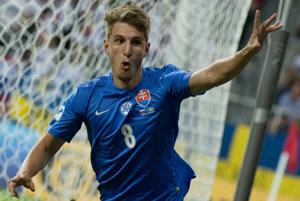 Na snímke Martin Chrien (Slovensko) sa raduje z úvodného gólu.