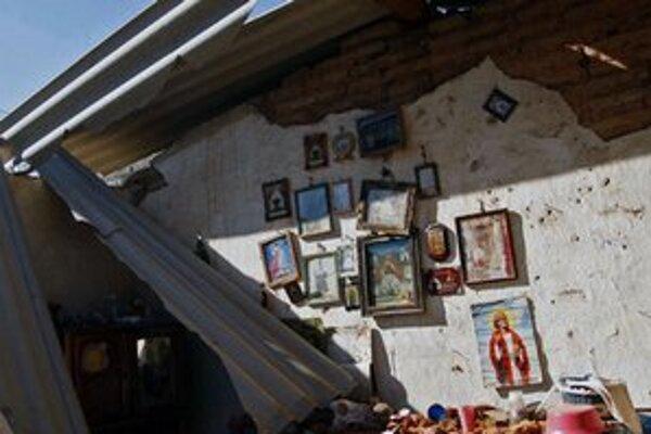 Zničený dom v meste San Juan Cacahuatepec.