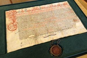 Na snímke detail listiny baníckeho bratstva svätej Barbory, ktorú sa podarilo reštaurátorskej dielni Slovenského národného archívu v Bratislave zachrániť.
