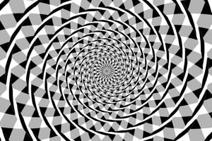Ilúzia Fraserovej špirály. Striedavá textúra kružníc spolu s pozadím spôsobujú, že vidíme špirálu. V skutočnosti sú však na obrázku kružnice. Pokojne po nich prejdite prstom.