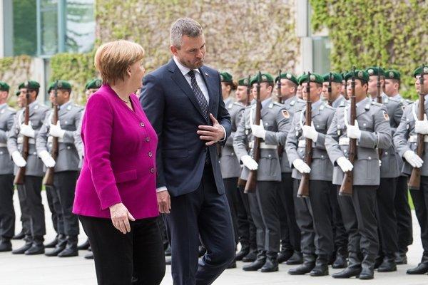 Pellegrini s Merkelovou.