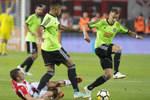 Na snímke sprava hráči FC Spartak Trnava Erik Grendel, Marvin Egho a Marko Jovičić (Belehrad) počas zápasu.