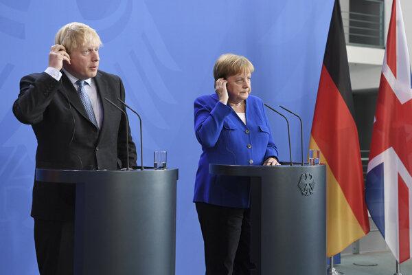 Britský premiér Boris Johnson a nemecká kancelárka Angela Merkelová.