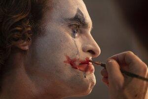 Joaquin Phoenix ako Joker.