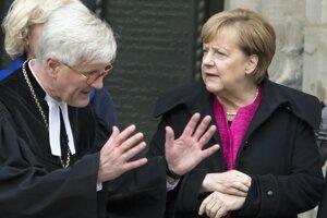 Biskup Heinrich Bedford-Strohm s kancelárkou Angelou Merkelovou.