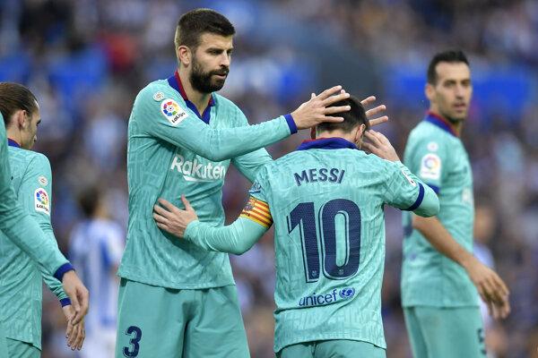 Gérard Pique a Lionel Messi.