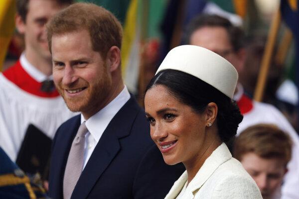 Princ Harry so svojou manželkou Meghan.