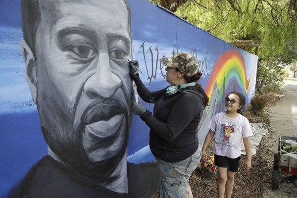 Umelkyňa maľuje portrét Georgea Floyda.