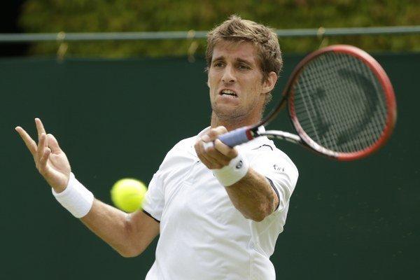 Martin Kližan vypadol na Wimbledone v prvom kole dvojhry aj štvorhry.