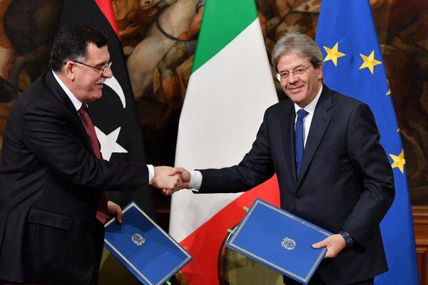 Premiéri Líbye a Talianska.