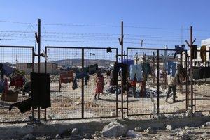 Utečenci na turecko-sýrskej hranici.