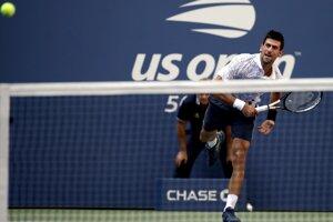 Novak Djokovič v zápase osemfinále proti Joaovi Sousovi.