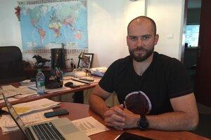 Tomáš Troliga vo svojej kancelárii.