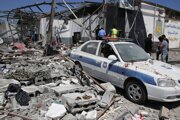 Škody po leteckom nálete na detekčné centrum na predmestí Tripolisu v júli 2019.