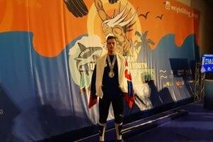 Vladimír Macura s medailou.