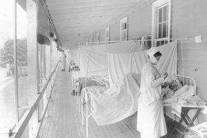 Zdravotná sestra meria pulz pacienta na chrípkovom oddelení nemocnice Walter Reed vo Washingtone.
