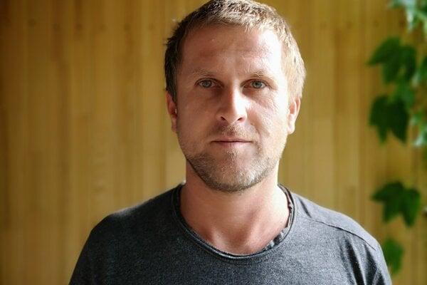 Marek Adamov.
