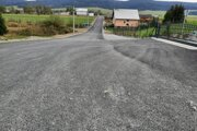 Nový asfaltový koberec v časti Lán.
