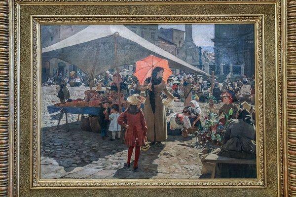 Najznámejší obraz Dominika Skuteckého Trh v Banskej Bystrici nájdete v stálej expozícii v jeho maliarovej vile, aktuálne je však na výstave v Bethlenovom dome.