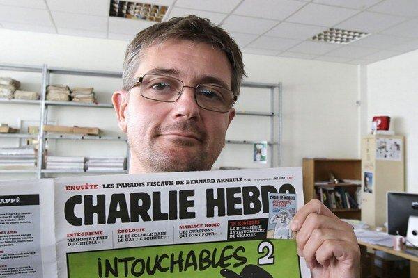 Šéfredaktor Charlie Hebdo Stéphane Charbonnier s karikatúrou z roku 2011. Pri útoku zomrel.