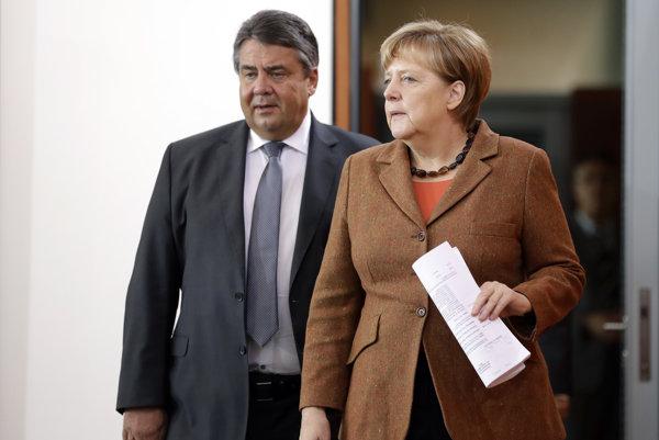 Predseda nemeckej Sociálnodemokratickej strany Nemecka (SPD) Sigmar Gabriel (57) nebude v blížiacich sa parlamentných voľbách vyzývateľom úradujúcej kancelárky a koaličnej partnerky Angely Merkelovej (vpravo).