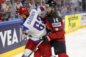 O puk bojujú Jevgenij Dadonov (vľavo) a Sean Couturier.