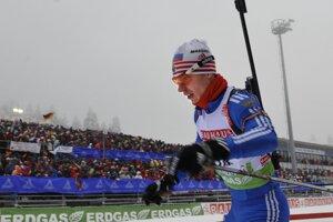 Ruský biatlonista Jevgenij Usťugov.