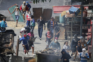 Demonštrácie v Caracase namierené proti režimu prezidenta Madura.