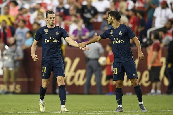 Na snímke hráči Realu Madrid zľava Gareth Bale a Marco Asensio v zápase Champions Cupu Arsenal Londýn - Real Madrid v americkom Landoveri 23. júla 2019.