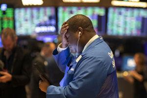 Maklér na finančnej burze v New Yorku.