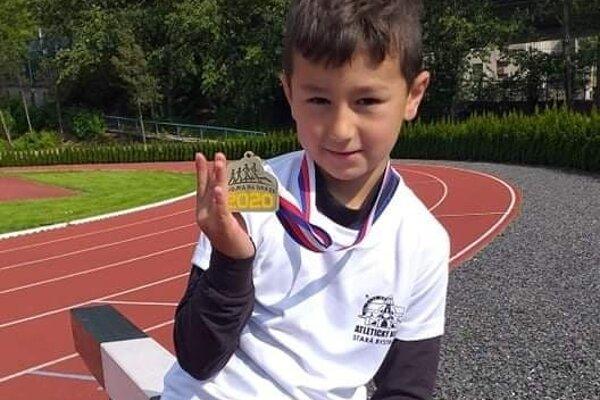 Roland Trocha so zlatou medailou.