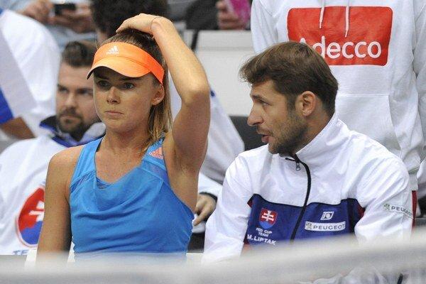 Nehrajúci kapitán Matej Lipták a Daniela Hantuchová počas duelu s Nemkou Angelique Kerberovou v zápase štvrťfinále svetovej skupiny Pohára federácie.