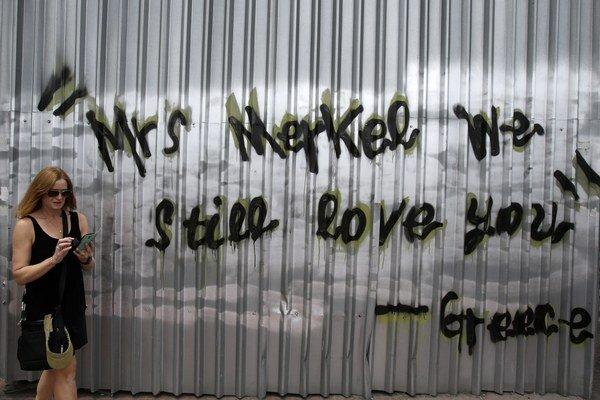 """""""Pani Merkelová, stále vás máme radi,"""" znie jedno z grafity v aténskych uliciach."""
