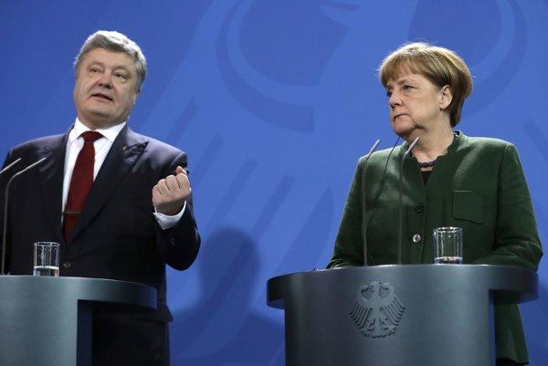 Petro Porošenko a Angela Merkelová.
