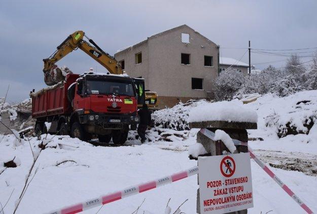 Demolácia budov.