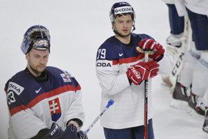Slováci potrebujú súhru okolností, aby postúpili do štvrťfinále. Na fotografii Libor Hudáček (vpravo) a jeho brat Július.