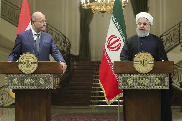 Iracký prezident Barham Salih spolu s iránskym prezidentom Hasanom Húránim.