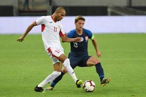 Patrik Hrošovský (vpravo) a Yassen Al-Bakhit v prípravnom zápase Slovensko - Jordánsko.