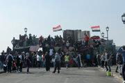 Protestujúci v Bagdade.