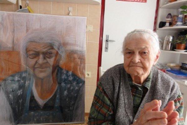 Emerencia Meňhartová s portrétom, ktorý dostala ako prejav vďaky. Statočná žena vychovala 8 detí, 15 vnúčat, 13 pravnúčat a 2 prapravnúčatá. Dodnes je čiperná, zaujíma sa o svoje okolie, sleduje aj dennú tlač, dokonca štopká.