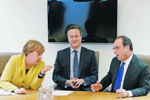 Angela Merkelová, David Cameron a François Hollande.