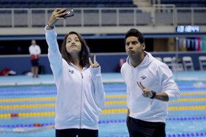 Plavci utečeneckého tímu - Yusra Mardiniová a Rami Anis.