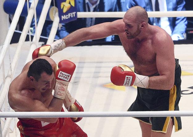 Posledný vzájomný súboj vyhral Tyson Fury (vpravo).