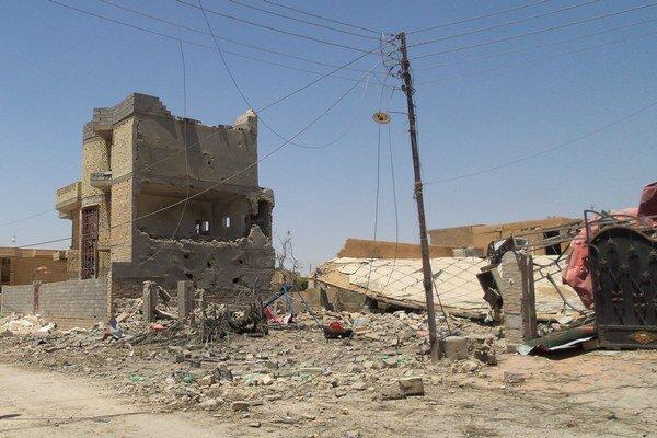 Zničené domy v Tikríte.