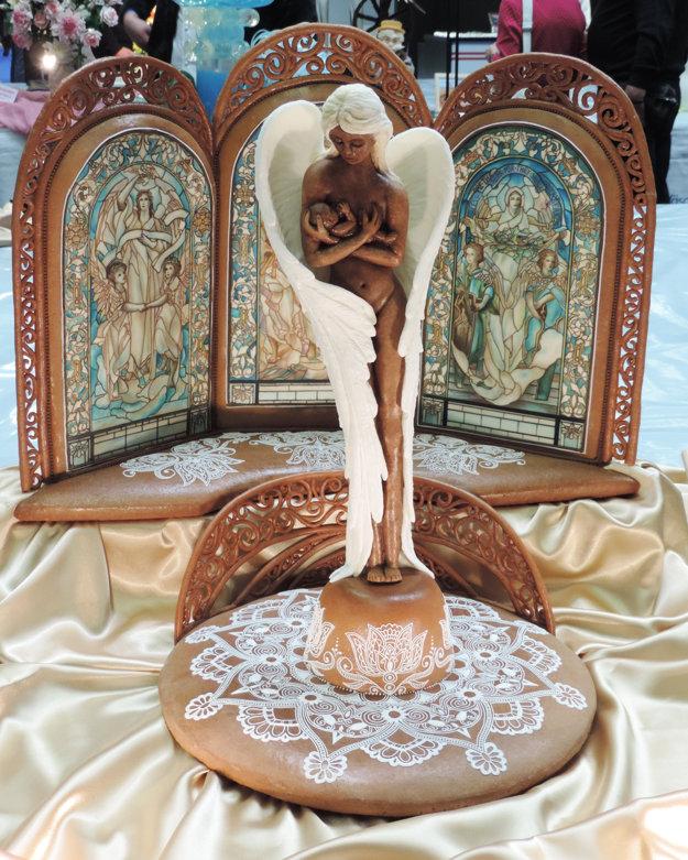 Hlavnou časťou diela je matka - anjel s dieťaťom v náručí.
