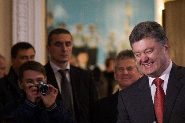 Spokojný prezident Petro Porošenko.