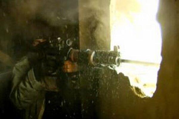 Sýrsky povstalec v meste Homs.
